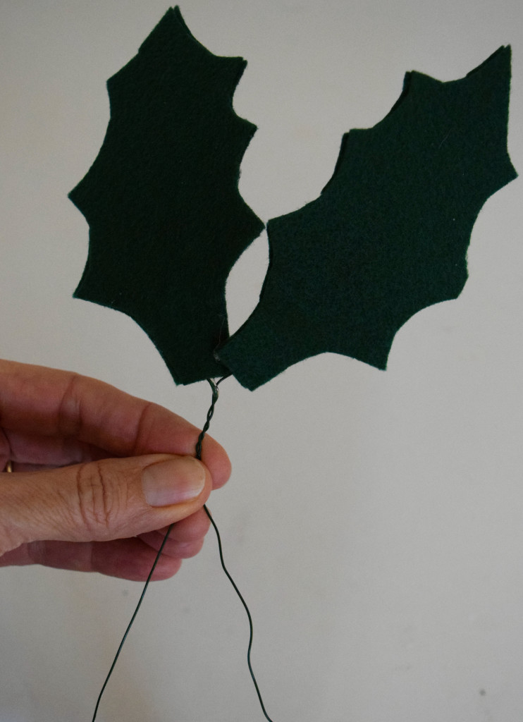Felt Holly Leaf Garland. Simple felt, some glue and wire come together as different twist on traditional garlands. At www.nourishandnestle.com