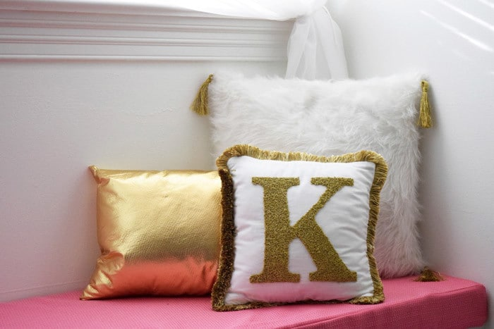 Get out your sewing machine and update your home decor with a passel of pretty, fancy shmancy DIY pillows. Perfect for a girl's bedroom.