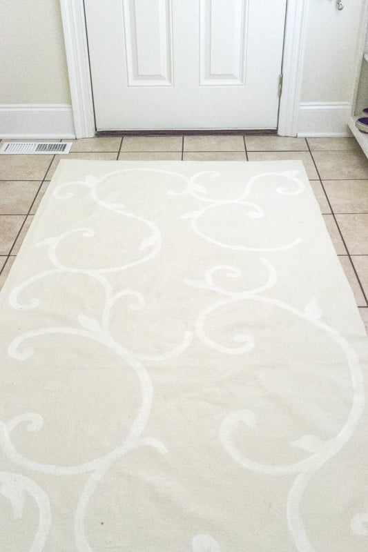How to make a floor cloth from a drop cloth. A painted rug for my laundry room is the DIY feature of week 5 of the One Room Challenge.