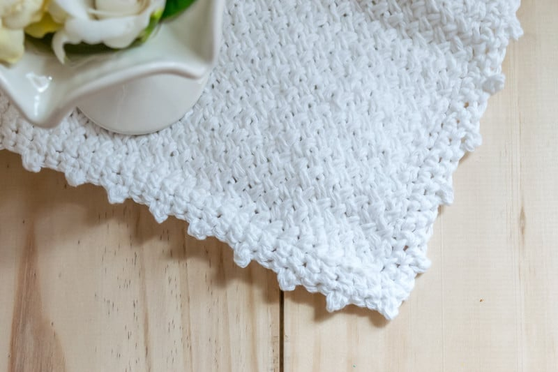 Instructions to knit a diagonal basket weave washcloth, with an added crocheted picot edging. Perfect for your home or for gifts.