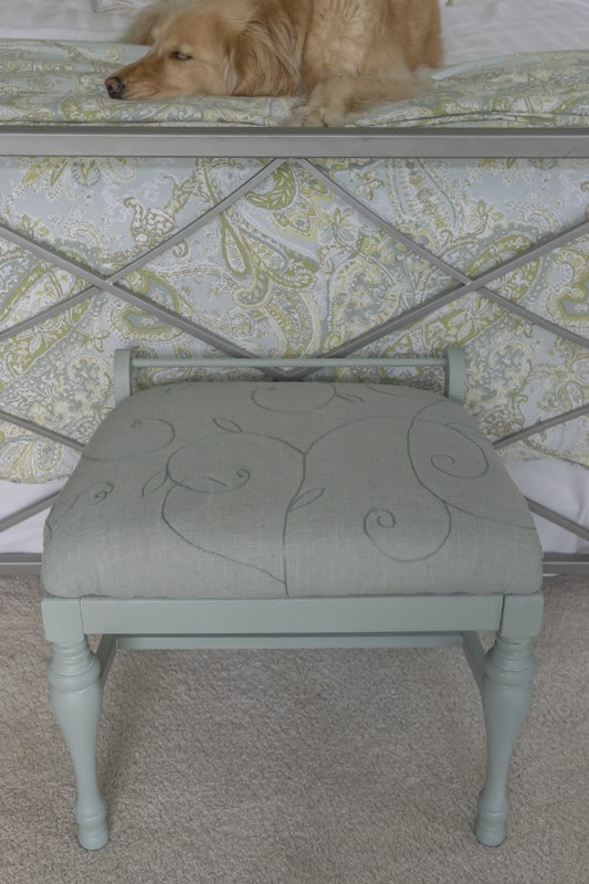 A little paint and some embroidered linen fabric transform a sad little bench into a real beauty. An easy DIY home decor project with step by step instructions.