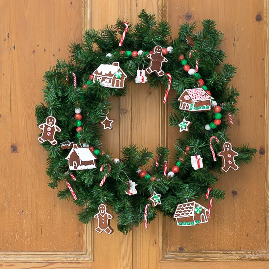 Cinnamon/Applesauce dough gingerbread men & houses and sculpey candy are the perfect ingredients for this sweet wreath for the holidays. Christmas Decor.