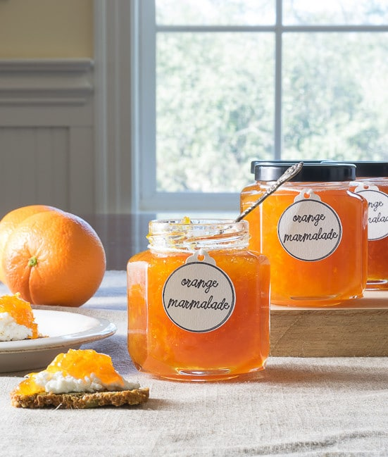 This Orange Marmalade recipe tastes like sunshine in a jar! And need a quick appetizer? How about a dollop of marmalade on top of goat cheese? An easy recipe with canning suggestions.