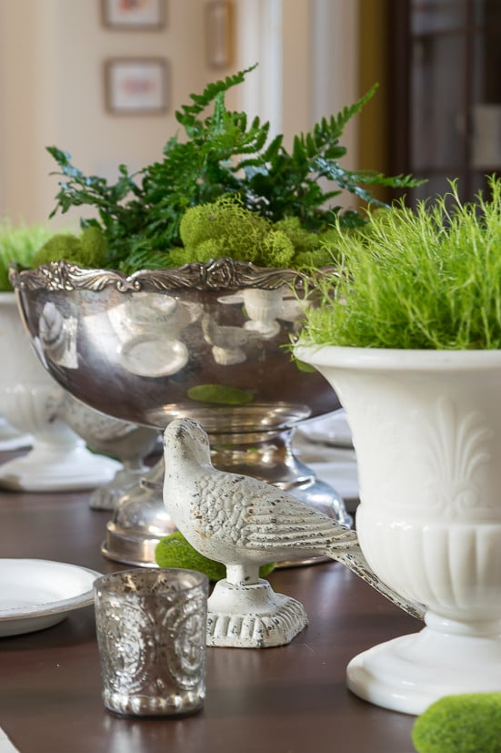 Spring Table Decor: Spring centerpiece flanked by moss filled urns