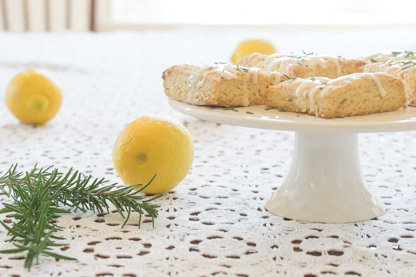 A easy and reliable recipe for light, tender and crumbly Lemon Rosemary Scones with a lemon glaze; perfect for breakfast, tea, snack or dessert.