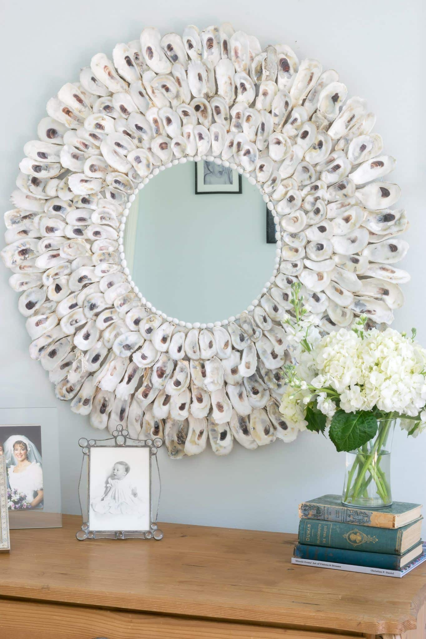 This DIY Oyster Shell Mirror is so easy to make and adds instant charm to your home decor. Not only perfect for coastal decor, but suitable for other decor styles as well.