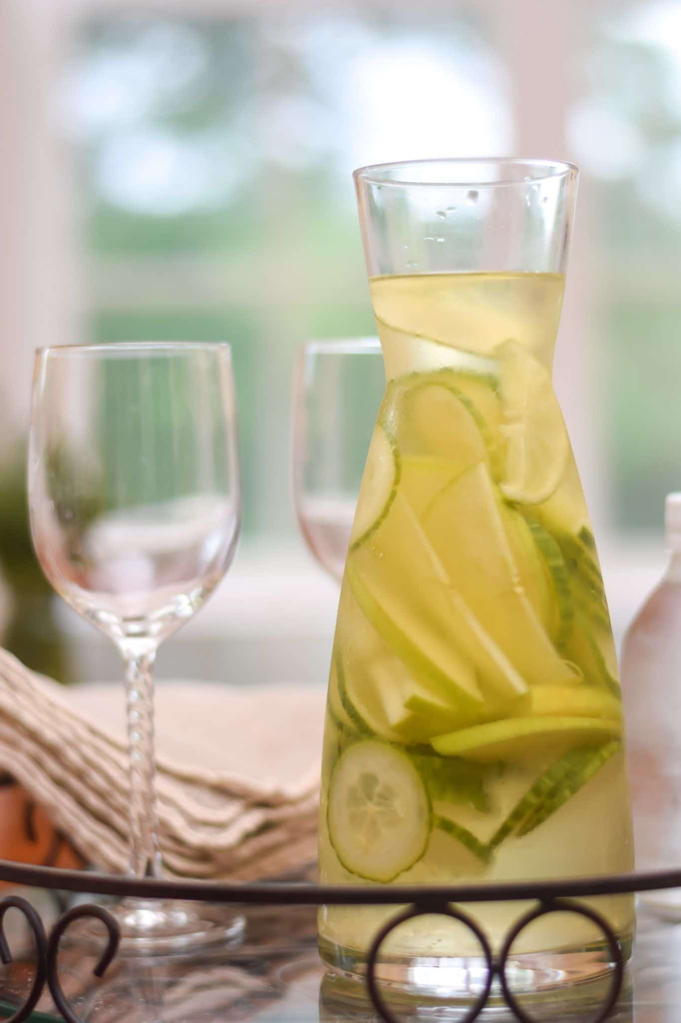 Oh yum..this White Wine Sangria recipe is perfect for a hot summer evening. The cucumber, apple and lime just really'dress up' a glass of wine. And topped with a splash of seltzer, it's the perfect and refreshing drink for entertaining or just relaxing.