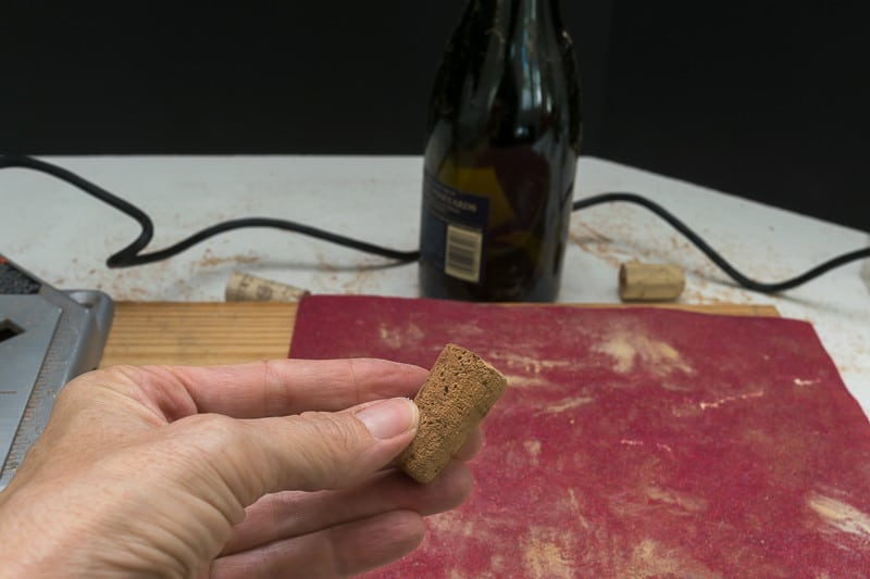 Sand your wine cork down to a taper