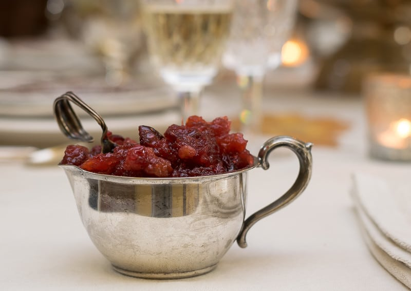 Cranberry relish with antique baby spoon on Thanksgiving table