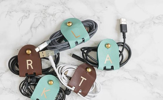 DIY Monogrammed Leather Cord Keepers are fairly quick to make, are so very useful! & make great gifts! Use your Cricut to cut the leather & iron on vinyl.