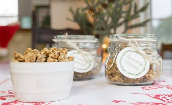Roasted Walnuts with Rosemary in a bowl and in jars with tags