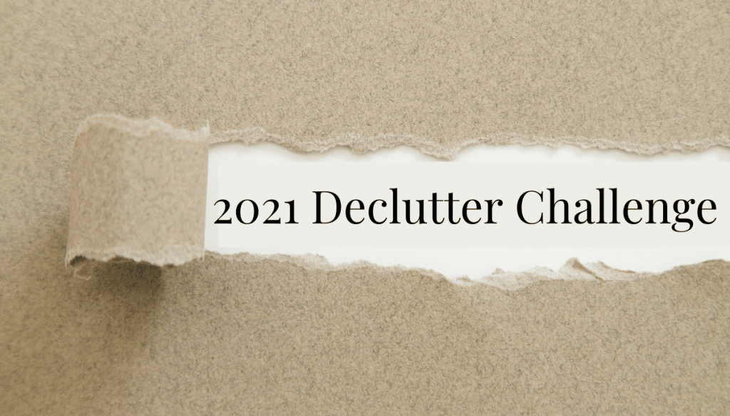 Ripped piece of paper with words 2021 Declutter Challenge